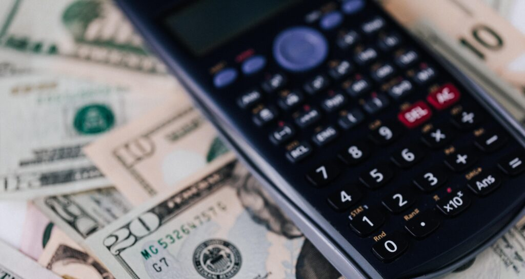 telecom expense management process: calculator is being used